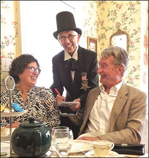 Peggy and Steve Pollick, retired Blade outdoors editor, seated, get 'prescriptions' filled by Mary Edwards Walker, portrayed by Sheila Otto.