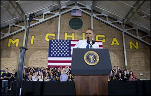 President Barack Obama speaks at the University of Michigan today.