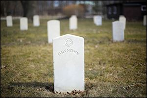 A tombstone for an unknown soldier in the the Confederate cemetery on Johnson Island.