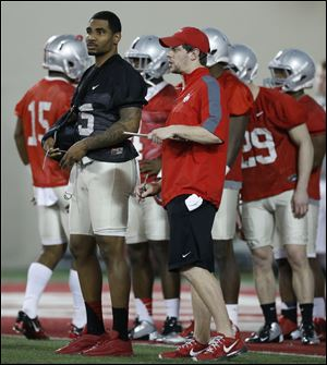 Ohio State quarterback Braxton Miller (5) watches the team practice at the Woody Hayes Athletic Center in Columbus.