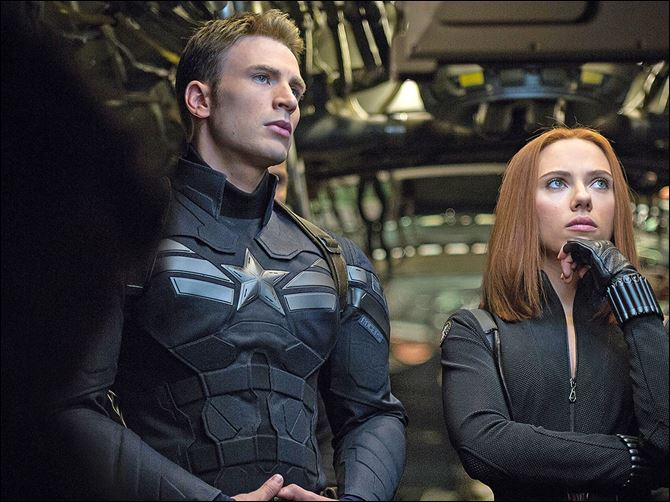 Film Review Captain America The Winter Soldier This image released by Marvel shows Chris Evans, left, and Scarlett Johansson in a scene from