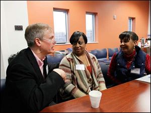 Stephen MacDonald, Bridges out of Poverty Coordinator, Lucas County Family Council, left, Vonda Williams, Lucas County Children's Services, and Janice Woodson, also with the Lucas County Children's Services.