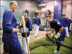 Toledo Mud Hens infielder Mike Hessman, left,  and outfielder Ben Guez during batting practice.