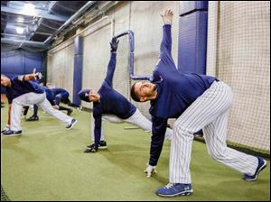 Toledo Mud Hens outfielder JD Martinez stretches out before batting practice.