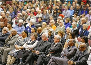 A diverse crowd attends the forum, including the Rev. Otis Gordon, far right, and the Rev. Robert Culp, second from right. They are co-chairmen of the Toledo Community Coalition, one of the sponsors of the event.