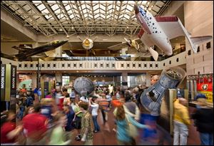 Visitors walk through the Milestones of Flight Gallery, the main hall of the Smithsonian's National Air and Space Museum, in Washington.