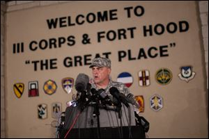 Lt. Gen. Mark Milley, commanding general of III Corps and Fort Hood, speaks with the media outside of an entrance to the Fort Hood military base following a shooting that occurred inside, Wednesday in Fort Hood, Texas.
