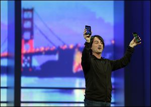 Microsoft Vice President Joe Belfiore holds up a phone using the new Windows 8.1 operating system during the keynote address of the Build Conference Wednesday in San Francisco. Microsoft kicked off its annual conference for software developers  with updates and new features for Windows Phone and Xbox.