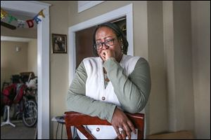 'This was a journey I was not proud of,' Rugena Modisett, at her home in West Toledo, says of her struggle with drug and alcohol addiction and subsequent recovery. All three of her children are afflicted with varying degrees of Fetal Alcohol Syndrome as a result of her drinking while she was pregnant with them.