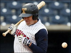 Toledo Mud Hens third baseman Mike Hessman is hit by a pitch against Louisville during the ninth inning.