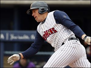 Toledo Mud Hens third baseman Mike Hessman takes a swing during the fourth inning.