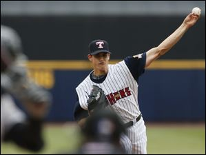Toledo Mud Hens pitcher Kyle Lobstein pitches against Louisville during the first inning.