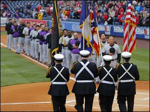 Members of the Toledo Fire and Rescue Department Honor Guard march the colors onto the field.
