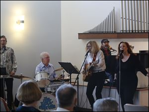 "The New Love Express in performance at Unity Church.  Unity of Toledo, ""A positive path for spiritual living"", at worship."