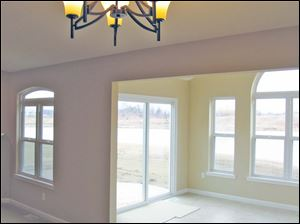 The sunroom offers a beautiful view of the pond.