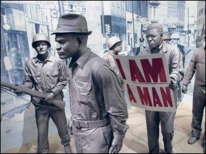 An exhibit on the 1968 protest march of Memphis sanitation workers at the re-imagined National Civil Rights Museum in Memphis. The museum, which opened in 1991 as one of the nation's first civil rights museums, reopens today after a $28 million reconstruction.