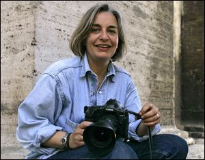 Associated Press photographer Anja Niedringhaus poses for a photograph in Rome in 2005. Niedringhaus, 48, was killed and an AP reporter was wounded on today when an Afghan policeman opened fire while they were sitting in their car in eastern Afghanistan.