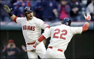 Cleveland Indians' Nick Swisher, left, celebrates with teammate Jason Kipnis after hitting a two-run home run.