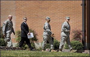 Fort Hood Lt. Gen. Mark Milley and other officials arrive for a news conference today on the base in Fort Hood, Texas.
