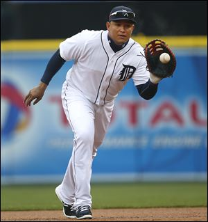 Detroit Tigers first baseman Miguel Cabrera fields a ground ball for an out in the first inning of a game in Detroit,