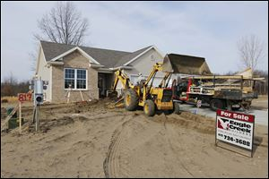 Workers with Gleckler Brothers Inc. of Metamora, Ohio, prepare the grade of a home so concrete can be poured in the Wingate Meadows subdivision in Springfield Township. With a break in the weather, area construction firms say demand is also springing up.