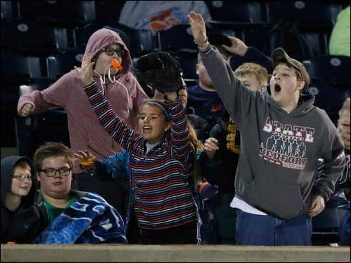 Toledo Mud Hens fans cheer during the ninth inning.