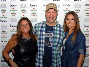 Matt Wagenhauser gets a photo taken with the event organizers, Stacy Meridieth, left, and Lori Lamb.