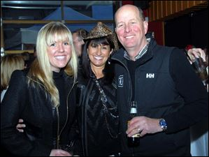 Kelly Fink, Lami Coyle, Kevin Fink having a good time at the Boots, Bling & Barbecue event.