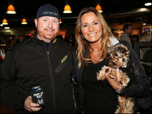 Mike Konst, of Genoa, left, Dawn Cox, of Sylvania, and her three-year-old Yorkshire Terrier Riley attended the Harley-Davidson Spring Fling at the Toledo Harley-Davidson.