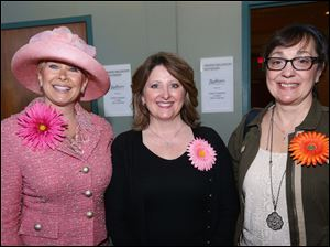 Joanie Barrett, of Holland, left, Trina McGivern, of Perrysburg, center, and Pam Pliz, of Perrysburg, right, attended the Toledo Symphony Rite of Spring at the the Radisson at UTMC in South Toledo.