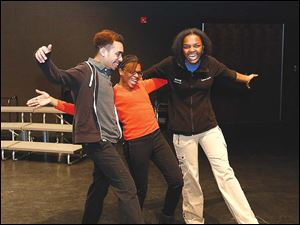 Willie Watkins, Brittany Schrencost, Danielle Bowman practicing their own moves.