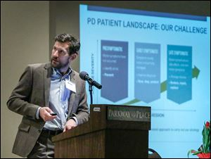 Dr. Brian Fiske speaks during the 17th annual Parkinson's Disease Symposium at Parkway Place in Maumee. Dr. Fiske delivered the keynote presentation at the event.