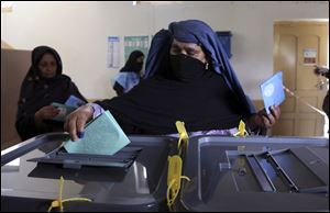 An Afghan woman casts her vote at a polling station in Jalalabad last Saturday.