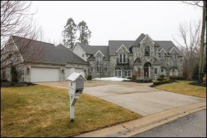 The house at 5 Riverhills Lane in Sylvania Township is listed at $1.035 million. It was built in 2005 and real estate taxes on the property are more than $27,000 per year.