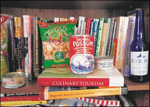 Food items that Lucy Long displays in her home sit atop two of her published books.