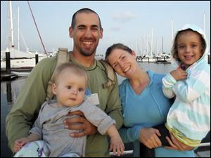 Eric and Charlotte Kaufman with their daughters, Lyra, 1, and Cora, 3.