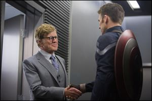 "Robert Redford, left, and Chris Evans in a scene from ""Captain America: The Winter Soldier."""