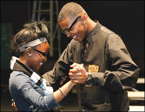 Woodward students Lyric Carter, left, and Dayshawn Jones get into the rhythm.