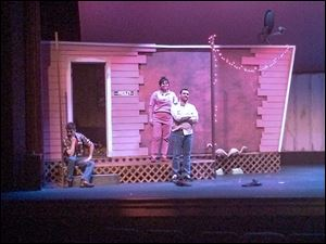 Cast members, from left, Christopher Smith, Amber Breault-Albain, and Jeremy Wilkes rehearse a scene from 'Great American Trailer Park Musical.' The cast will perform Friday, Saturday, and Sunday.