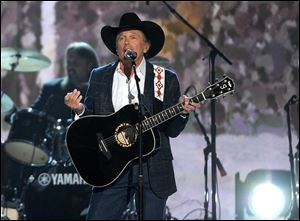 George Strait performs t the 49th annual Academy of Country Music Awards at the MGM Grand Garden Arena on Sunday in Las Vegas. Strait won his second entertainer of the year — 25 years after he won his first — on Sunday.