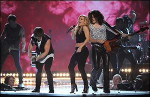 Siblings Neil Perry, from left, Kimberly Perry, and Reid Perry of the Band Perry kick off the 49th annual Academy of Country Music Awards at the MGM Grand Garden Arena.