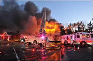 Firefighters respond to a multiple alarm fire at the popular Lakeview Pavilion in Foxboro, Mass. A wedding was taking place at the time of the fire.