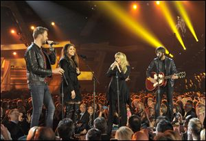 Stevie Nicks, second from right, and from left, Charles Kelley, Hillary Scott and Dave Haywood, of the musical group Lady Antebellum, perform at the MGM Grand Garden Arena in Las Vegas.