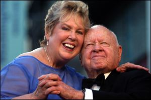 Jan, left, and Mickey Rooney pose for photographs in April, 2004.