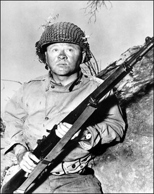 "Actor Mickey Rooney is shown in this file photo as G.I. Dooley in the 1956 Hollywood movie ""The Bold and the Brave."""