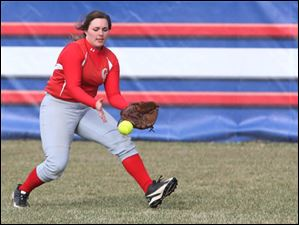 Central Catholic's senior right fielder Alyssa Axe scoops up a long hit during the bottom of the third inning.