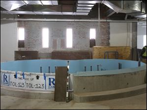 A shallow tank is under construction inside the aquarium of the Toledo Zoo.
