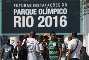 Striking workers stand in front the entrance of the Olympic Park, the main cluster of venues under construction for the 2016 Summer Olympic Games, in Rio de Janeiro, Brazil today.