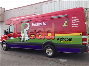 The Toledo-Lucas County Public Library's Ready to Read van features artwork from the book 'Alphabet Under Construction.'