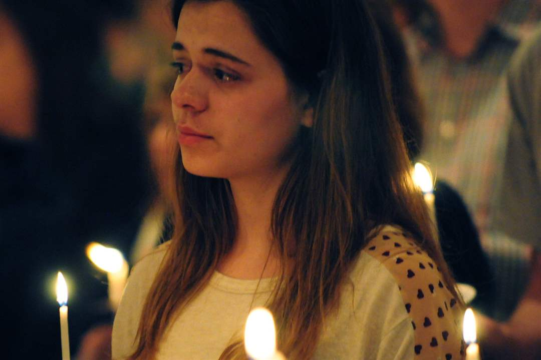 A-girl-tears-up-during-a-prayer-and-vigil-service